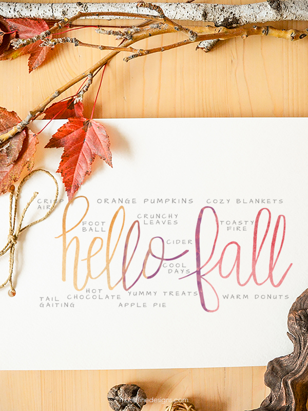 It's easy to decorate for fall with this free Hello Fall Watercolor Printable. Add it to a frame and put it on your mantle for the perfect fall decor.