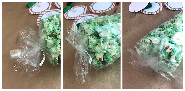 """This free printable Christmas Tree Place Card with white chocolate popcorn is super easy to make. Kids will love how the """"kid's table"""" is decorated!"""