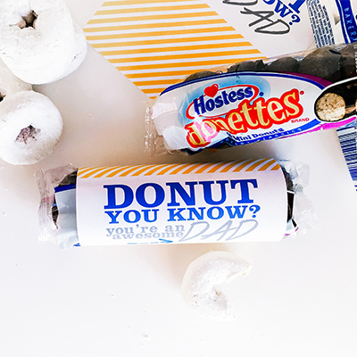 Let your kids get give dad DONUTS for Father's Day! Use the free printable wrapper for a quick and easy gift the kid's can make in less than 5 minutes.
